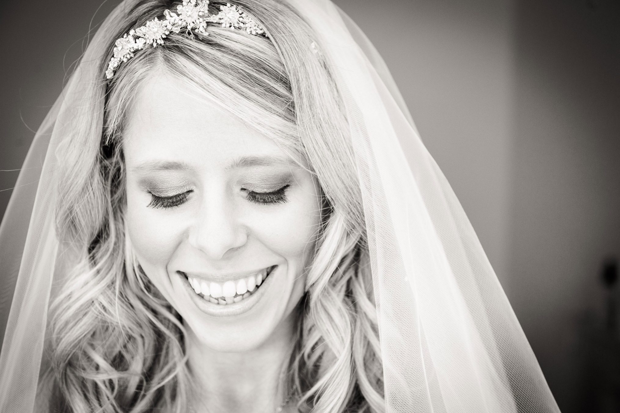bride-smiling-after-putting-on-her-veil