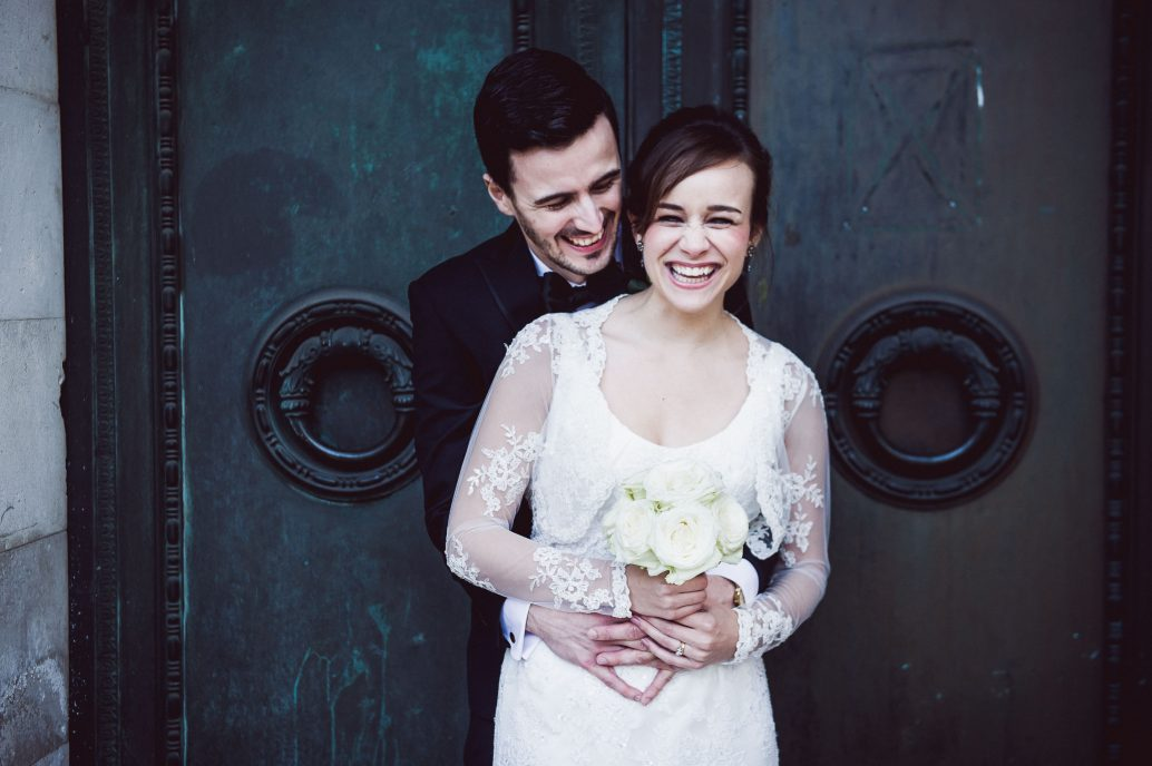 Bride-and-groom-laughing-at-wedding-in-Cardiff