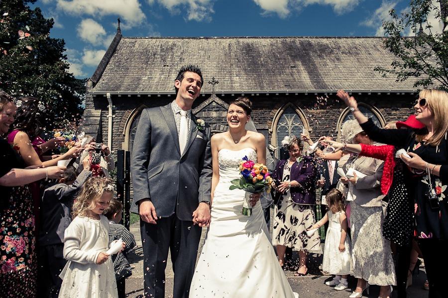 bride and groom in a confetti line
